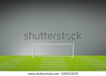 football concept showing empty football pitch and football goal posts with goal net and space for text