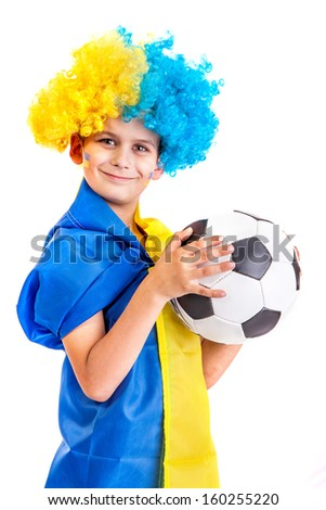 Football fan with a blue and yellow ukrainian flag painted on his face and a ball in hands on white background