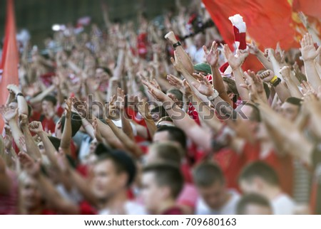 Football fans clapping on the podium of the stadium #709680163