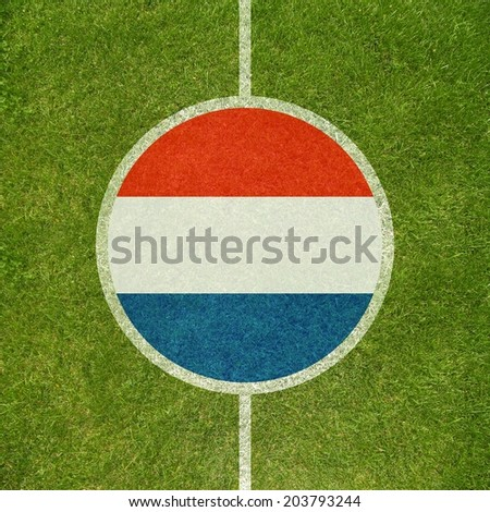 Football field center closeup with Dutch flag in circle  #203793244