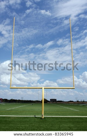 Football Field Goal Posts with a cloudy sky