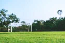 Football field, Goal with blue sky, Selective focus, blurred