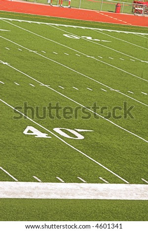 Football field viewed from stadium bleachers.