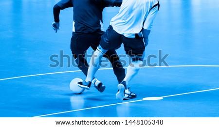 Football Futsal Ball and man Team. Indoor Soccer Sports Hall.