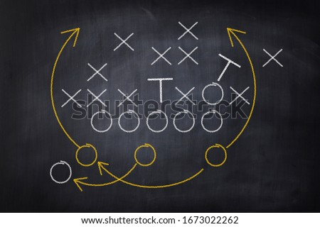 Football game plan on blackboard with white chalk. Strategy concept of tactic board Foto stock ©