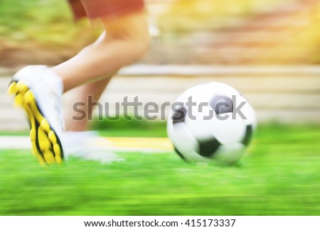 Football game slow motion, body part, sportive teen boy runs for ball, soccerl championship, active teens lifestyle, recreation and hobby