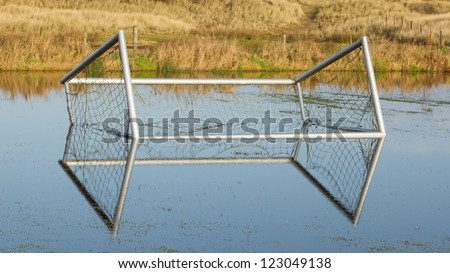 Football goal in a flooded field in Holland