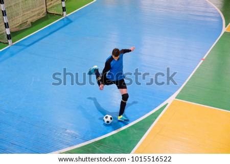 Football goalkeeper on goal, field, Small Futsal ball field in the gym indoor, Soccer sport field #1015516522
