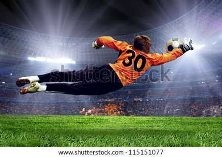 Football goalman on the stadium field
