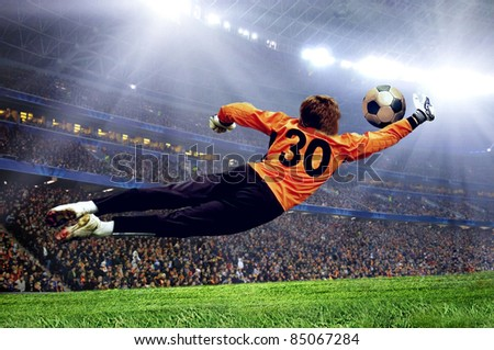 Football goalman on the stadium field - stock photo