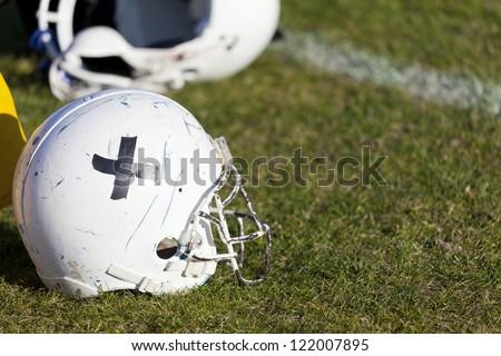 Football helmet on the floor of the stadium