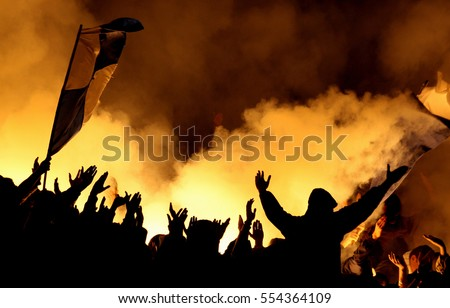 Football hooligans with torches on stadium, fans #554364109