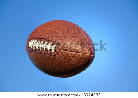Football in flight - stock photo
