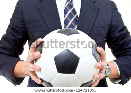 Football manager hold ball with his hands in studio