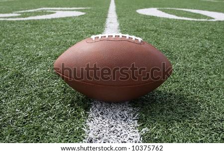 Football near the 50 yard line