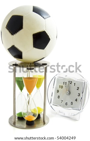 Football on a hourglass with a clock isolated over white