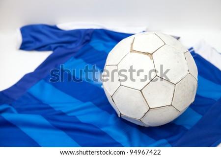Football on blue shirt background