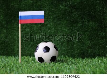 football on Green grass and flag Russian #1109309423