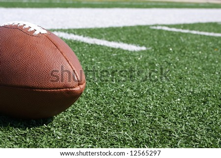 Football on the field with room for copy - stock photo