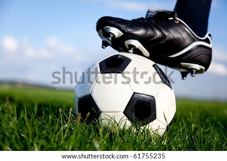 Football or soccer ball at the kickoff of a game outdoors