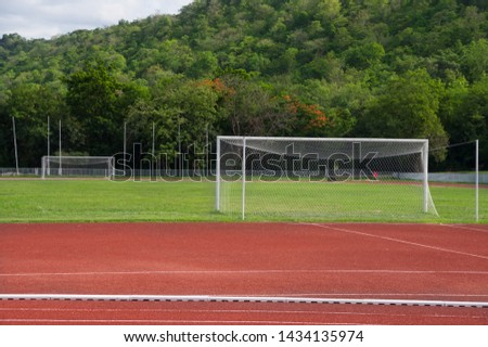 Football or soccer field and goal in sport stadium. #1434135974