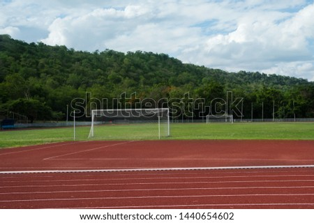 Football or soccer field and goal in sport stadium. #1440654602