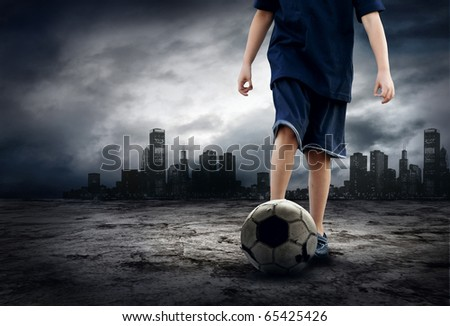 Football player and Grunge ball on the retro grunge background