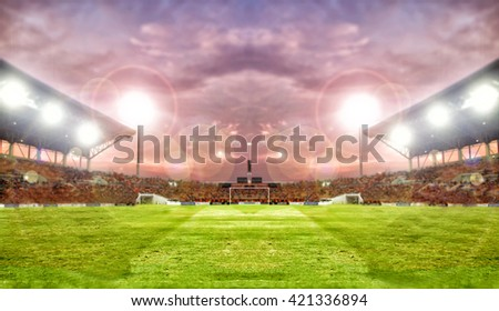 football player and soccer player holding ball on football stadium and stadium arena soccer field championship win for background ,soft focus