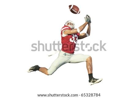 football player catches ball in midair