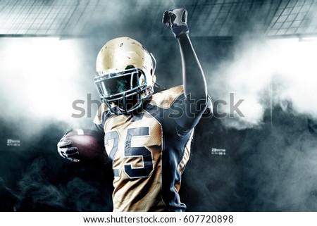 Football player celebrates after scoring a touchdown.