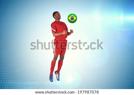 Football player in red jumping against technical screen with pixels