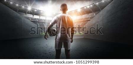 Football player in the stadium #1051299398