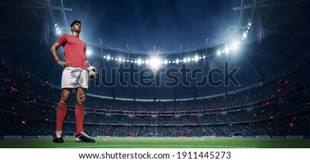 Football player in the stadium. An imaginary stadium is modelled and rendered.