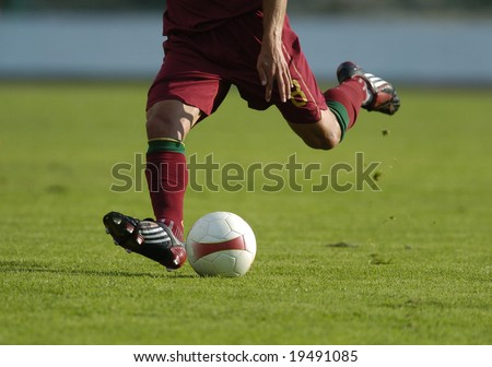 football player kicking a ball