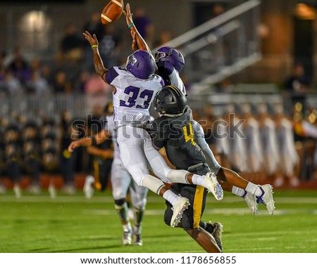 Football player making an amazing play during a game