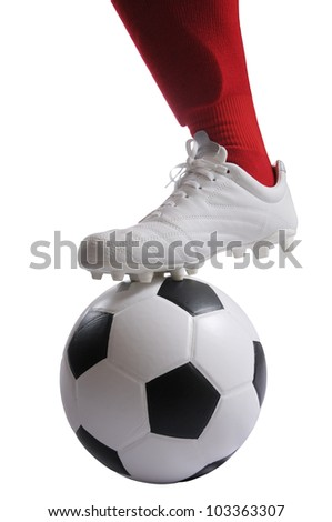 Football player on using foot keep and stop a football in the game