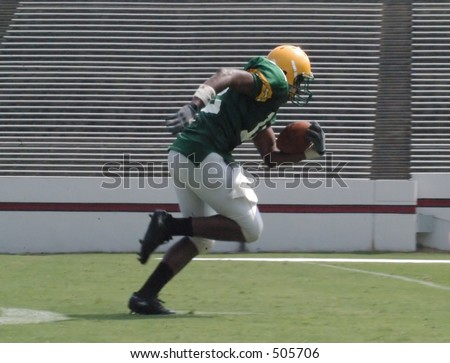 Football player running to endzone