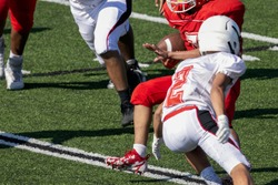Football Player running toward the end zone
