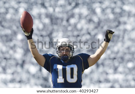 Football Player Scoring a Touchdown