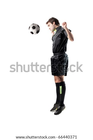 Football player shooting a ball with his hand