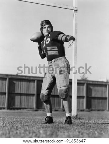 Football player throwing ball