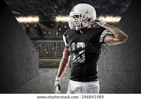 Football Player with a Black uniform on a stadium tunnel.