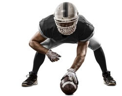 Football Player with a black uniform on the scrimmage line, on a white background.