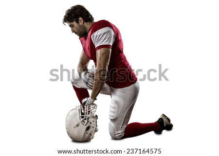 Football Player with a red uniform on his knees, on a white background.