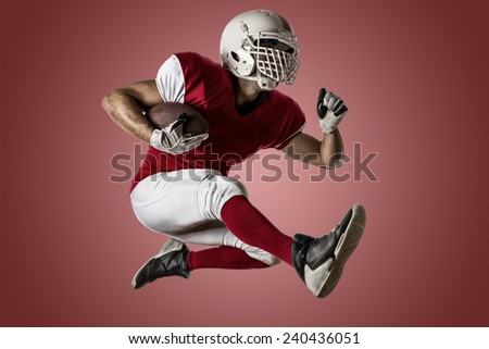 Football Player with a red uniform Running on a red background.