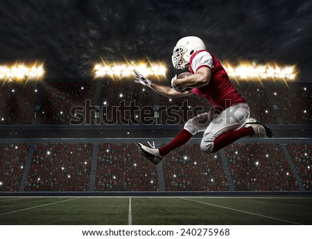 Football Player with a red uniform Running on a stadium.