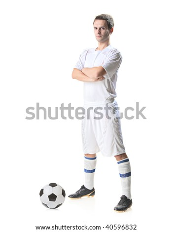 Football player with a soccer ball isolated against white background