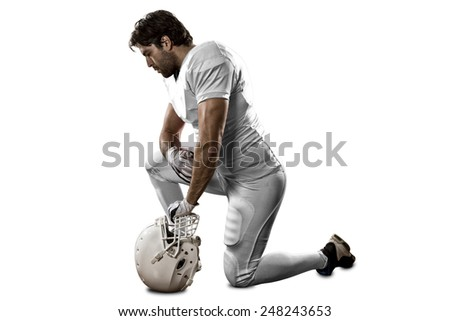 Football Player with a white uniform on his knees, on a white background.