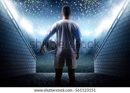 Football player with ball in the stadium #561123151