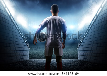 Football player with ball in the stadium #561123169